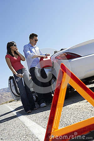 Warning Triangle With Couple Pouring Fuel Into Car