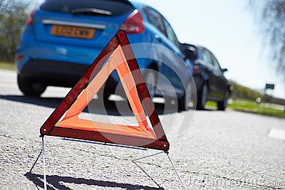 Warning Triangle By Two Cars Involved In Accident