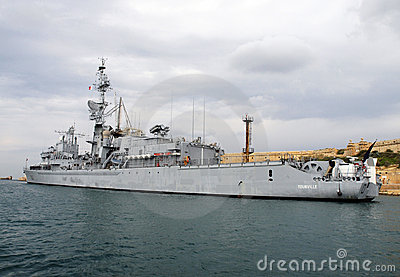 Warship heading out of Maltese Harbour Editorial Stock Photo