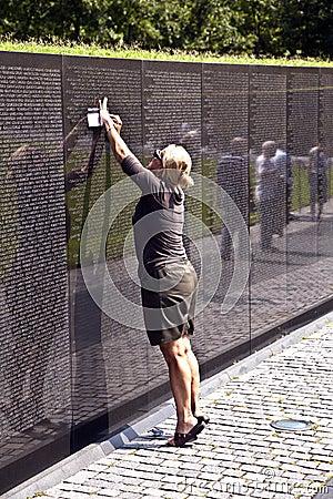 Woman In Front Of Vietnam Veterans Memorial In Washington ...
