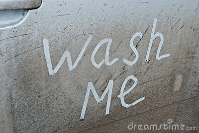Wash me written on a dirty car