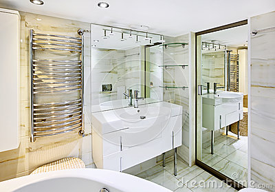 Wash stand with mirror in bathroom interior