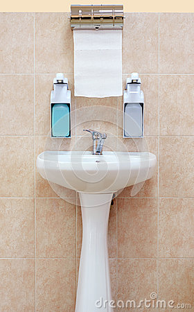 Washbasin with a paper towel and liquid soap