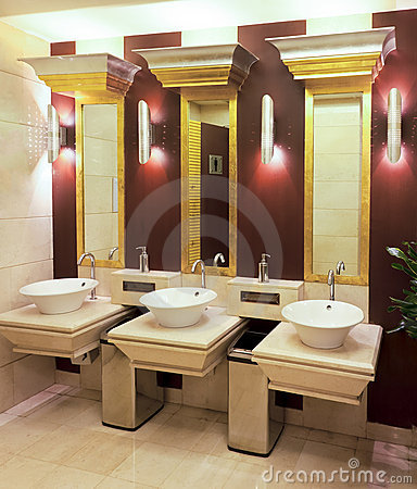 Washbasins, taps and mirror in public toilet