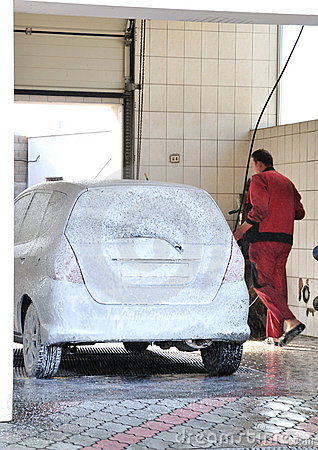 Washerman washing Car at Car-wash service