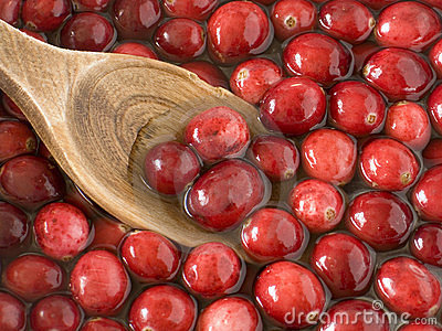 Washing cranberries with an antique wooden spoon