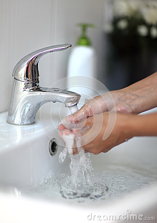 Washing of hands with soap