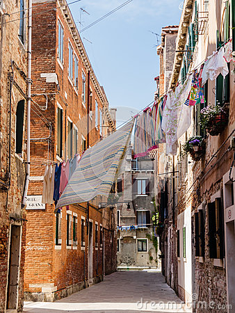 Free Washing Hanging Between Houses In A Narrow Street Stock Photo - 87509850