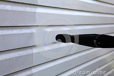 Washing the vinyl siding Stock Photo
