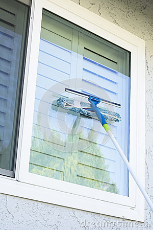 Washing Window On A Home Stock Photo Image 62694371