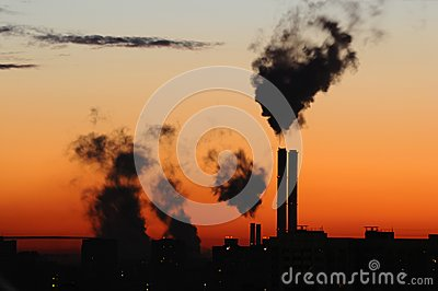 Waste gas fumes emission in sunset/sunrise
