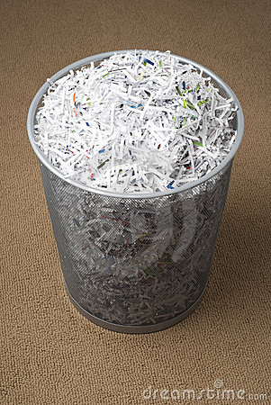 Wastepaper basket filled with shredded paper