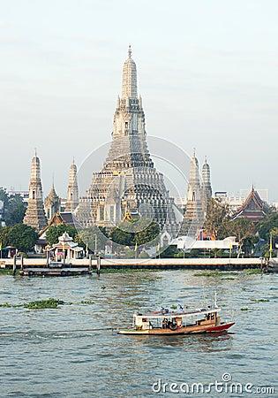 Wat Arun by Chao Phraya river in Thailand
