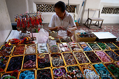 Wat Arun. Precious stone prayer beads vendor. Editorial Stock Photo