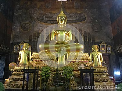 Golden Buddha with 3 disciples Statues Editorial Stock Photo