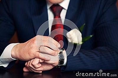 Watch on the groom's hand Stock Photo