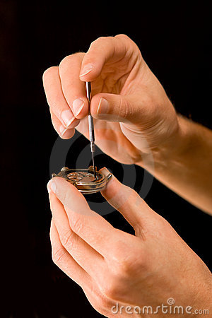 Watch-maker repairing old abraded watch