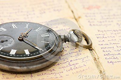 Watch on an old notebook with the text