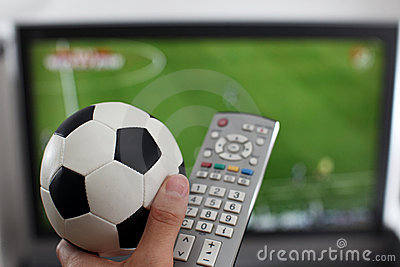 Watching TV with ball and remote