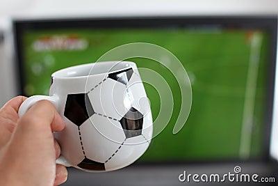 Watching TV with a coffee mug