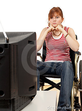 Watching tv woman on the wheelchair