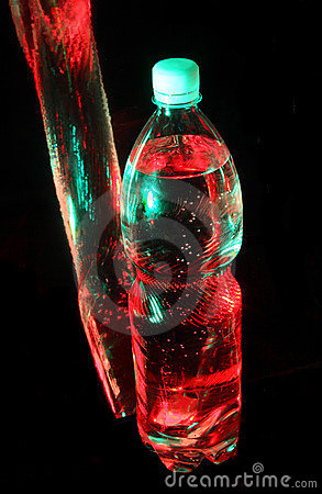 Water bottle in colored lights