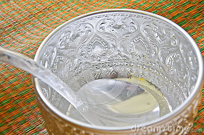 Water bowl made of silver on the mat