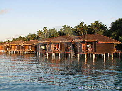 Water bungalows at sunset
