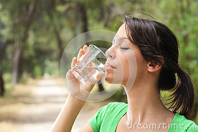 Water drinking in glass