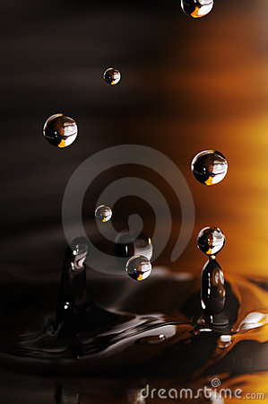 Water drop in rippled liquid