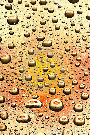 Water drops on orange glass