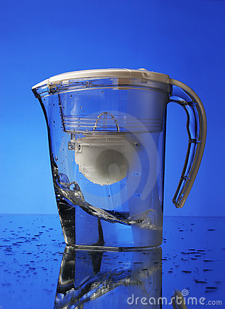 Water filter on blue background