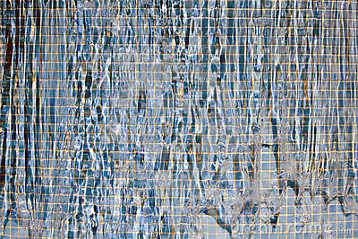 Water flow over blue mosaic
