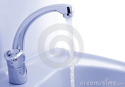 Water flowing from the faucet