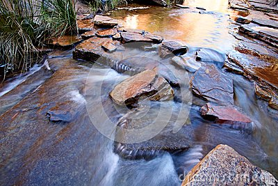 Water flowing over boulders
