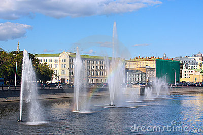 Water fountains with rainbow in river