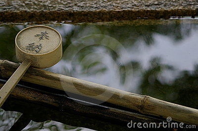 Water ladle and reflection.