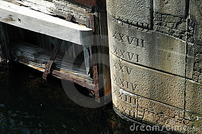 Water level markings on a dock