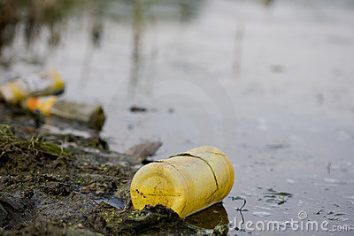 Water pollution - plastic bottle on river surface