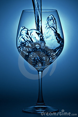 Water pour into wineglass