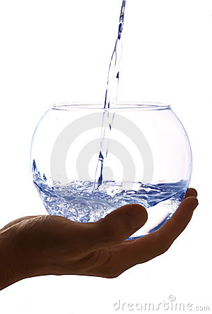 Water is poured into a large glass