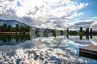 Water Reflection Clouds Trees Boat Dock Stock Images