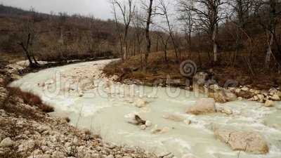 Water river flow after raining. Flow of brown water in the river after storm stock footage