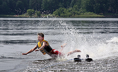 Water Skier falling and about to crash into a lake