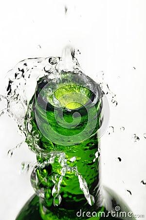 Water splash over bottle