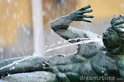 Water spouting statue