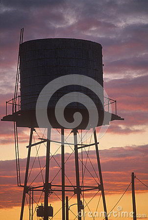 A water tank at sunset