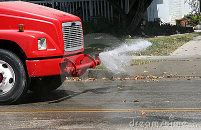 Water truck cleaning street