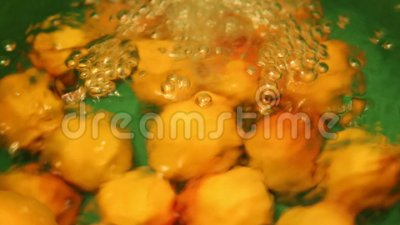 Water washing apricots
