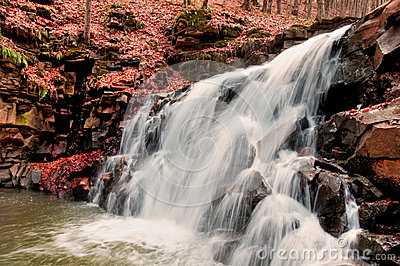 Waterfall. Autumn forest